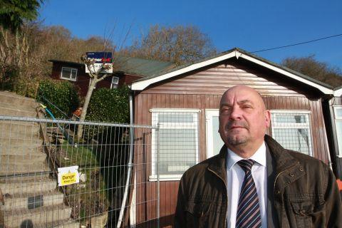 Lyme Regis deputy town clerk John Wright at the chalet site