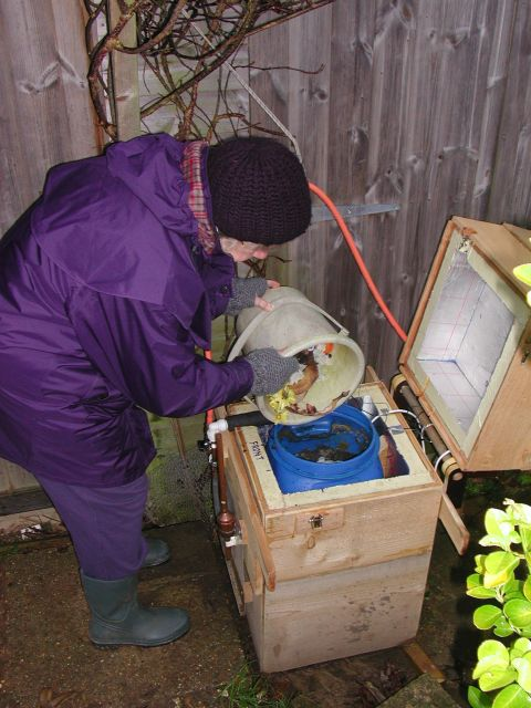 A Bridport Renewable Energy Group member using the anaerobic digester