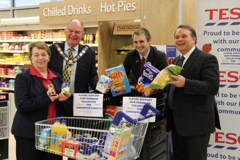 The food bank appeal is launched at Axminster Tesco by community champion Kath Rabjohn and customer service manager James Sedgwick, backed by town mayor Andrew Moulfding and MP Neil Parish