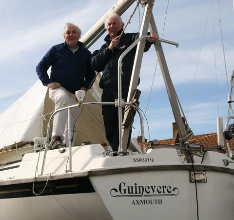 Axe Yacht Club member Nick Jolly aboard his boat, Guinevere, with volunteer RNLI sea safety officer Richard Finch
