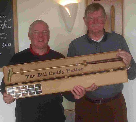 PETER'S PRIZE: Peter Marshall, left, receives the Bill Caddy Putter from veterans' captain Roger Pollock