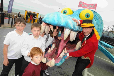 Peter Courtnay with the travelling Pliosaur and pupils from Shute Primary School at last year's Lyme Regis Fossil Festival.