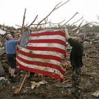 Residents place an American flag on debris in Moore, Oklahoma (AP)