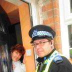 PROACTIVE CAMPAIGN:  PCSO Mark Brown gives a  warning leaflet to resident Val Moore