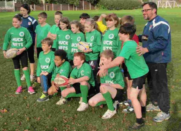 HAVING A BALL: Bridport Primary School tag rugby squads with coaches Guy Ferner and Faye Leins