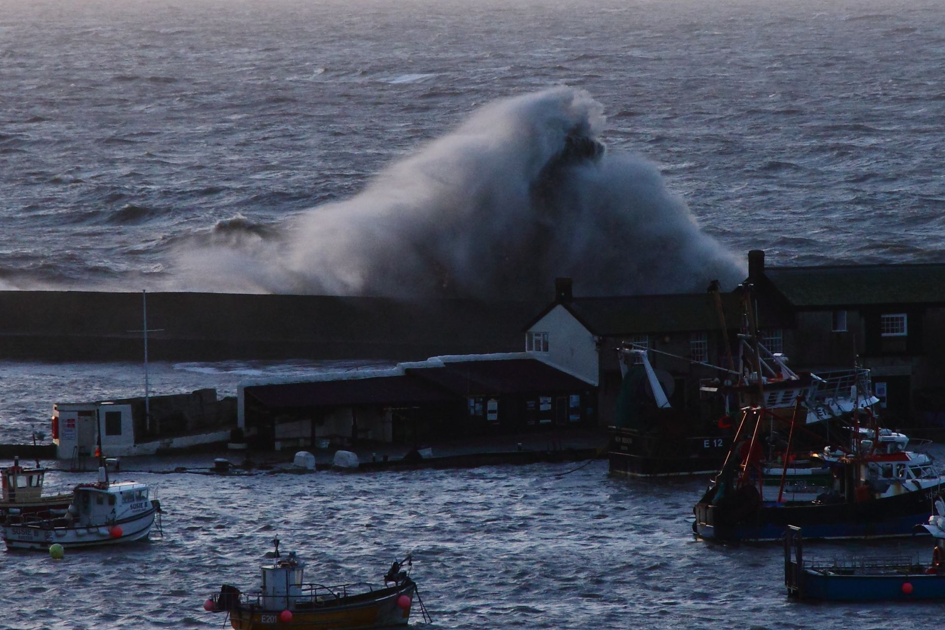 Vessels sunk by stormy conditions in Lyme Regis harbour. Picture by Robin Morrison