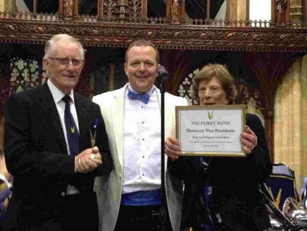 Tony and Margaret Greenham and guest conductor Mark Peacock with their specially framed certificate.