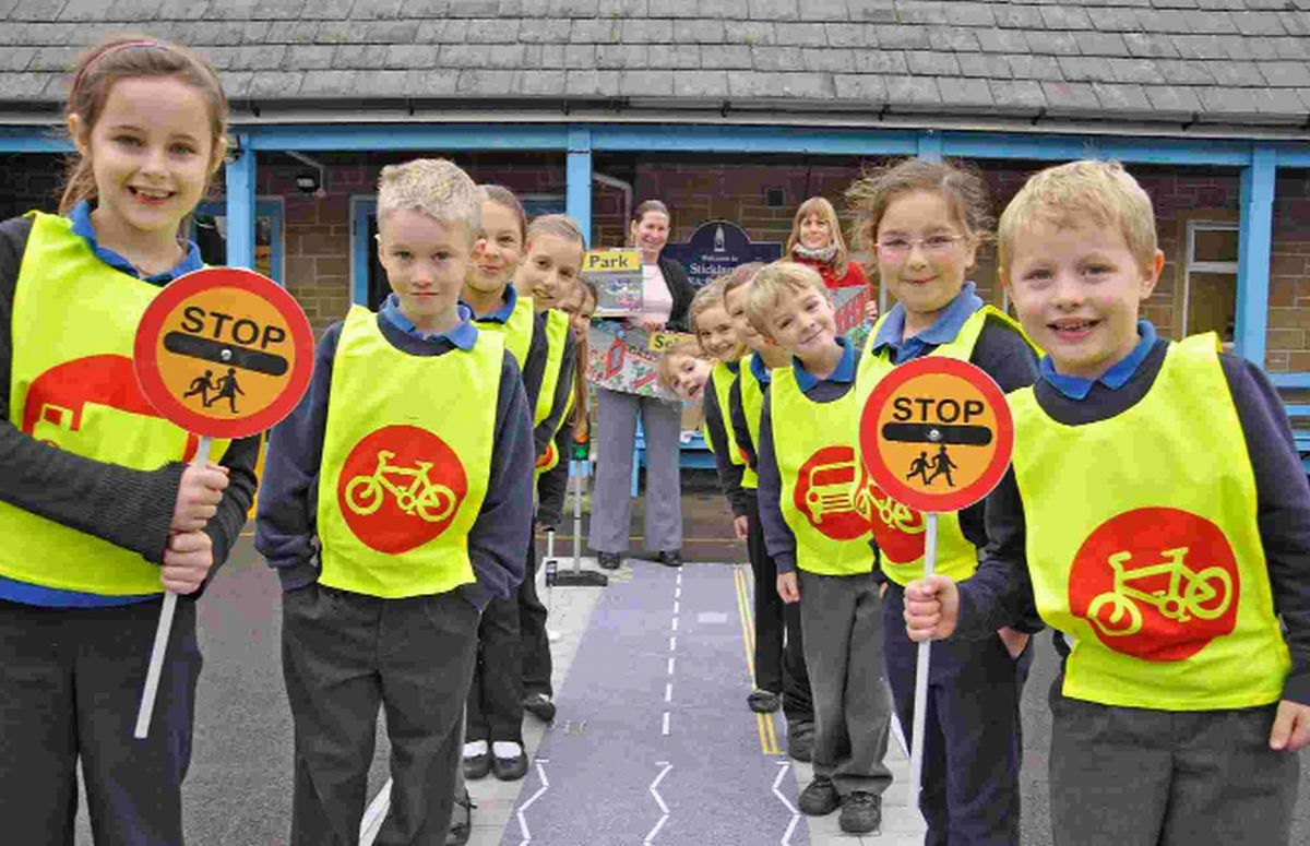 MAKING SENSE: Pupils try out the road safety kit. In front, from left, are Gracie, Thomas, Ruby and Olly. Looking on are headteacher Kathy McCann, rear left and Battens' personal injury solicitor Hannah Brown