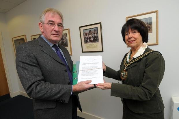 WDDC chairman Gillian Summers receives the petition