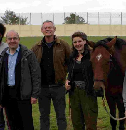 IT WORKS! Harriet Laurie, the founder of the charity HorseCourse, with patrons Martin Clunes, and Lord Jim Knight the horse Flower and inmates at Portland Young Offender Institution