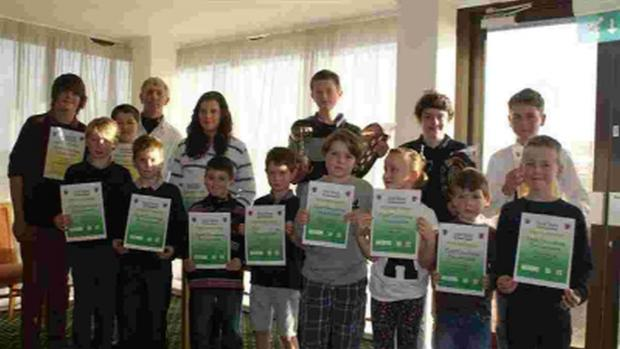 Bridport and Lyme Regis News: JUNIOR SHOW: Members of Bridport & West Dorset Golf Club with their trophies and certificates