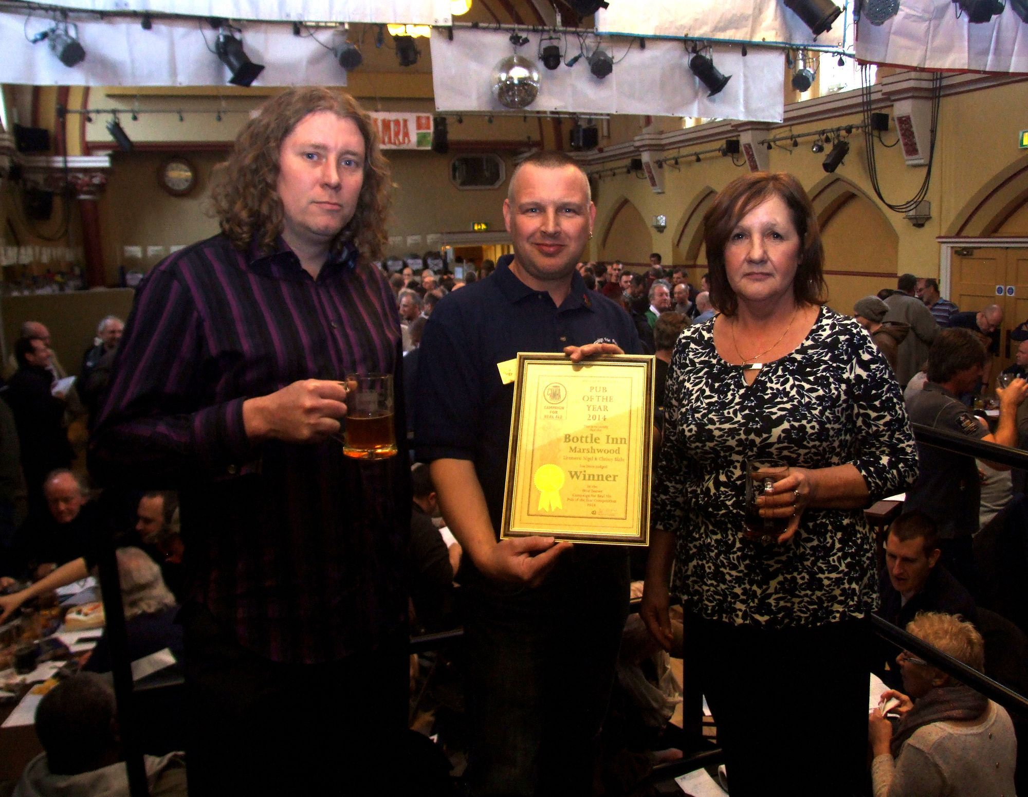 CAMRA's Rich Gabe, centre presents Nigle and Chrissy Blake of the Bottle Inn with top honours.