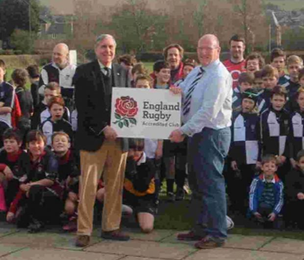 Bridport and Lyme Regis News: CLUB HONOUR: Dorset & Wilts RFU president John Palmer, left, hands over the Club Accreditation plaque to Bridport RFC's junior chairman Julian Hussey