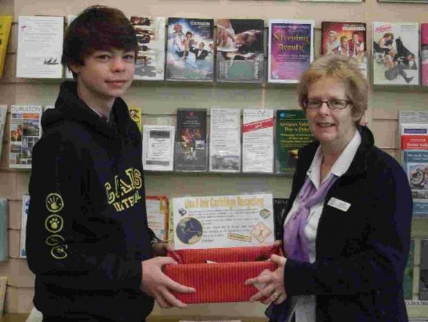 Bridport and Lyme Regis News: IMAGINATIVE: Mandy Green of Bridport TIC with Benji Jackson and a drop-off box