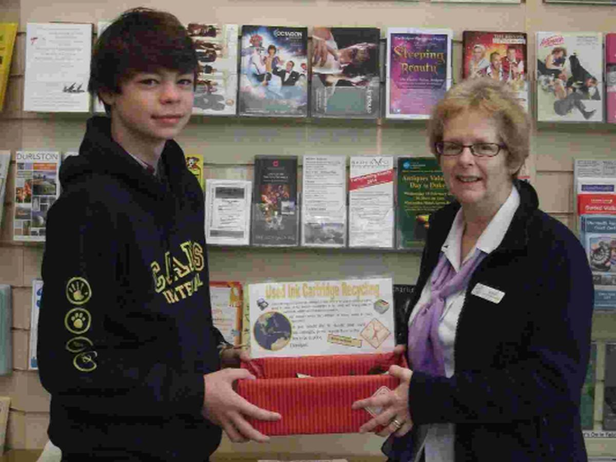IMAGINATIVE: Mandy Green of Bridport TIC with Benji Jackson and a drop-off box