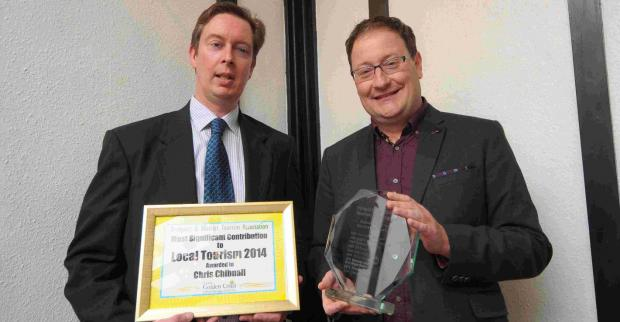 Chris Chibnall, right, receives his tourism award from Scott Condliffe