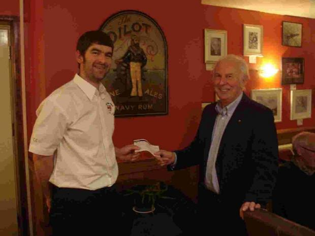 Bridport and Lyme Regis News: DONATION: Richard Finch, right, presents a cheque for £500 to Helmsman Tim Edwards