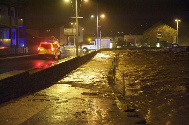 Bridport and Lyme Regis News: DANGER LEVEL: West Bay Harbour last night  Picture: GRAHAM HUNT