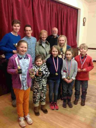 TROPHY WINNERS: Back from left, Ollie Lee, Levi Gale, Lesley Lee, Mike Kite, Olivia Willmore. Front, Daisy Parsons, Maisie Herbert, Lucy Reeves, Katie Shaw, Toby Reeves
