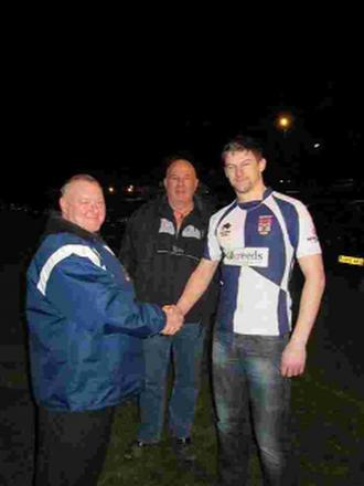 HEAD COACH: Bridport club captain Dave Cutting, right, shakes hands with new head coach Roger Clark, left.  First-team manager Grant Connelly looks on in the centre