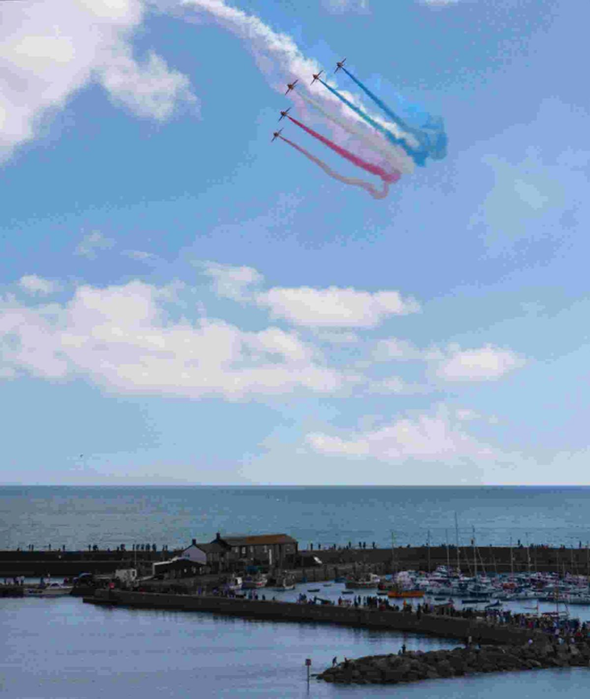 SKY HIGH: The Red Arrows soar over Lyme Regis as one of the highlights of Lyme Regis Lifeboat Week