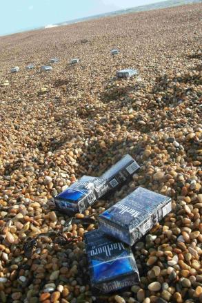 WASHED UP: Cigarette packets on the beach