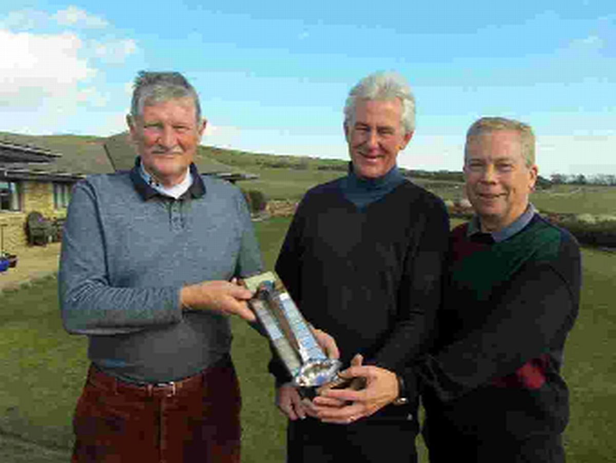 LADLE PRIZE: Vets' captain Roger Pollock, left, presents Roy Gill, centre, and Malcolm Peach with the Luton Ladle