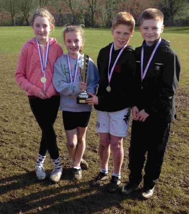 FOUR-MIDABLE: The St Mary's quartet that won the A team race show off their trophy