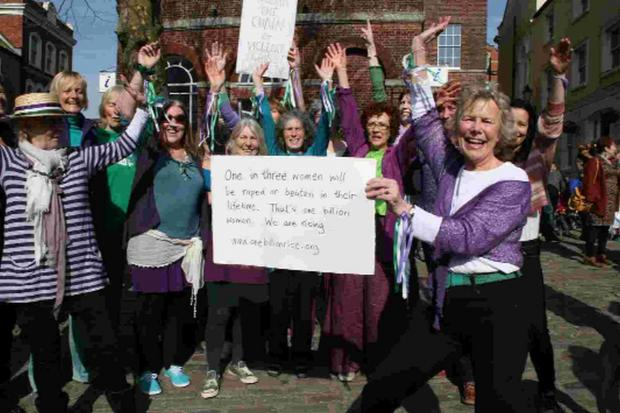 Bridport and Lyme Regis News: SISTERS UNITED: Margie Barbour, front right, joins in International Women's Day celebration in Bucky Doo Square