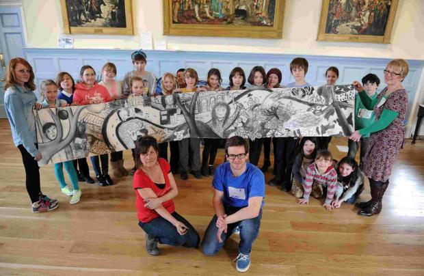 Artist Veronica Hudson and organiser Rupert Lloyd with pupils and some of their finished artwork