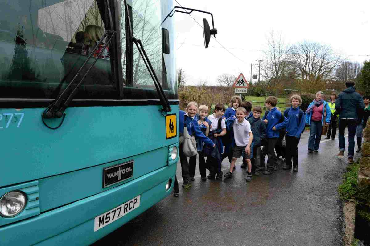 BIG ISSUE: Litton Cheney school pupils make their way down a narrow lane to meet the school bus  Picture: JOHN GURD JG150120