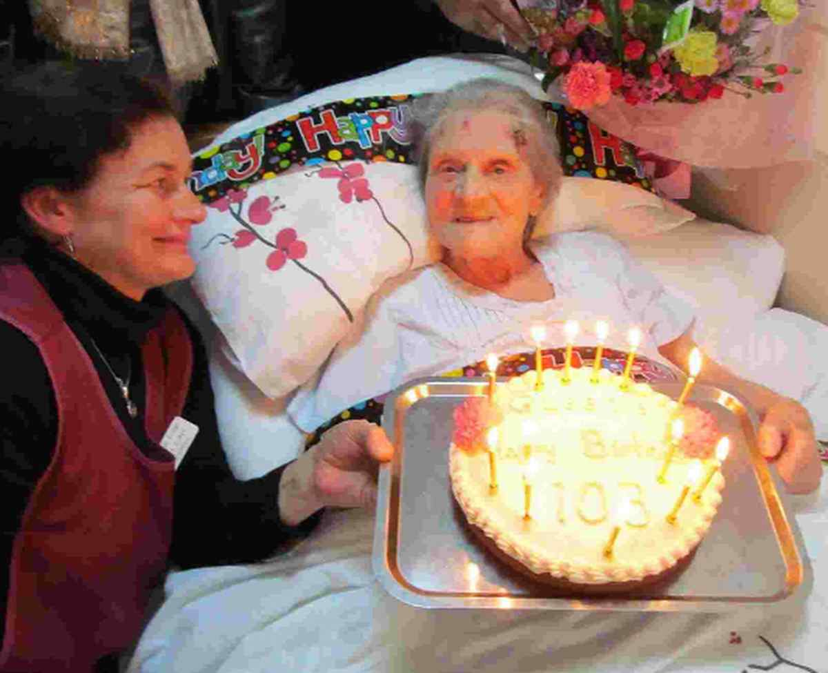 HAPPY BIRTHDAY: Queenie Hodge  celebrates her big day at Coneygar Lodge in Bridport with staff member Louisa Roper