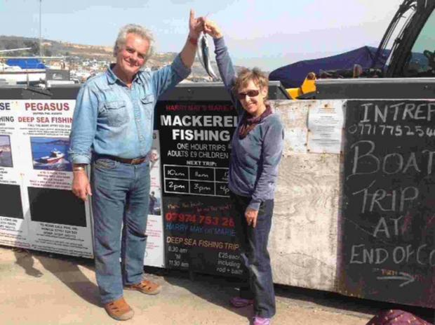 GOOD CATCH: Fisherman Harry May presents town mayor Sally Holman with the three mackerel caught this year