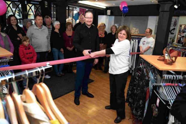 OPEN FOR BUSINESS: Chris Chibnall at the Cancer Research UK shop in Bridport with shop manager Pat Blake