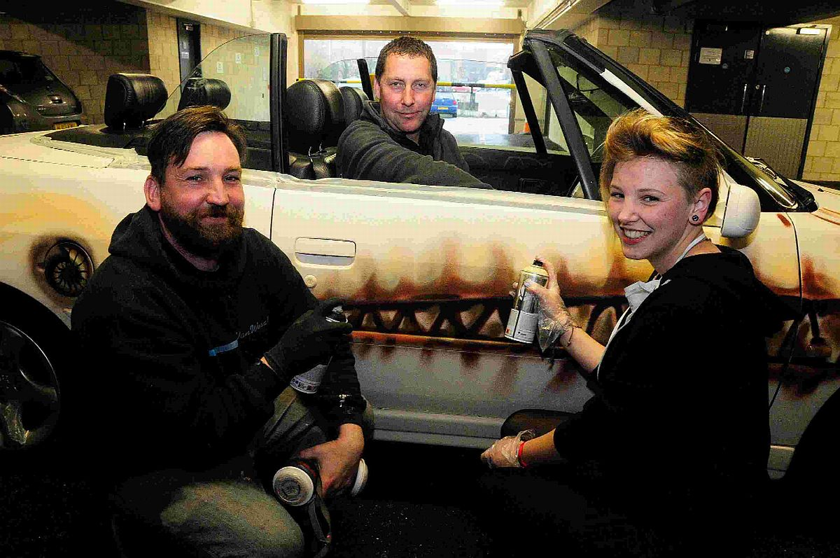 Graffiti artists Peter Sheridan and Demi Watts with Monaco or Bust car driver Neil Siford