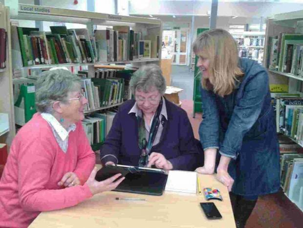 Bridport and Lyme Regis News: Wendy Maggs, right, helps Ailsa Royston and Wendy Hounsell, left with basic tablet skills