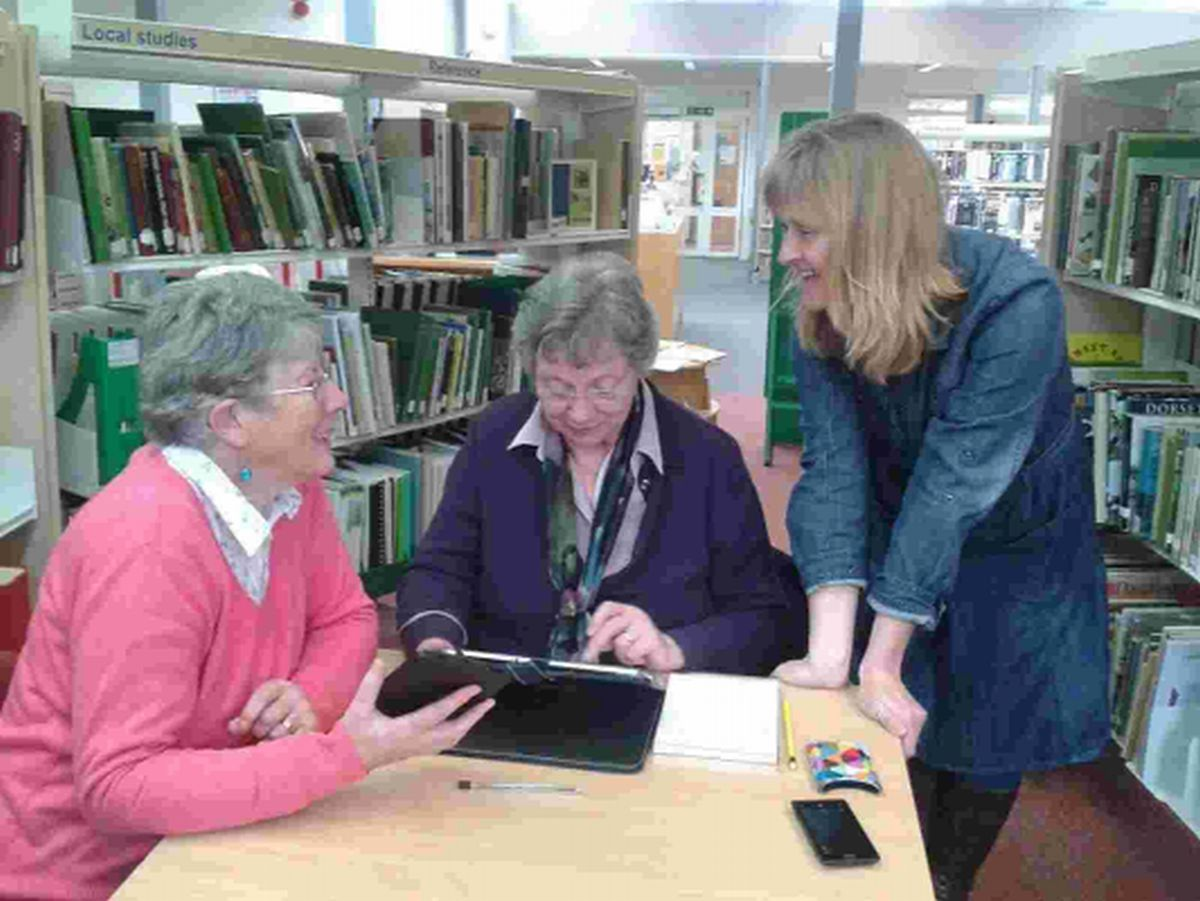 Wendy Maggs, right, helps Ailsa Royston and Wendy Hounsell, left with basic tablet skills
