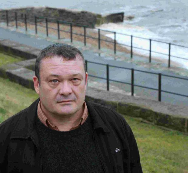 ROOM FOR IMPROVEMENT: Cllr Mark Gage at Church Cliff Beach