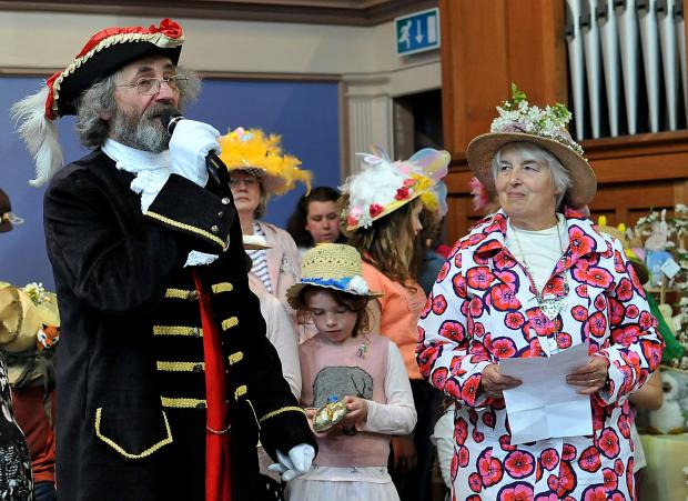 Bridport and Lyme Regis News: Town crier Alan Vian with cllr Lorna Jenkin presenting the awards