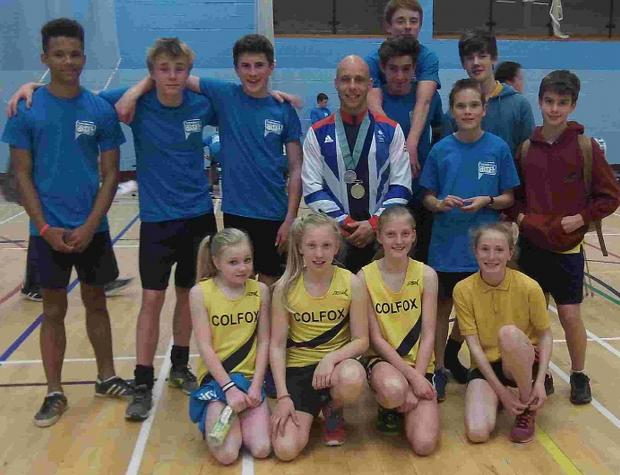Bridport and Lyme Regis News: COLFOX CREWS: Colfox School's indoor rowing teams at the Dorset Youth Games, with Olympic silver medallist diver Pete Waterfield, centre