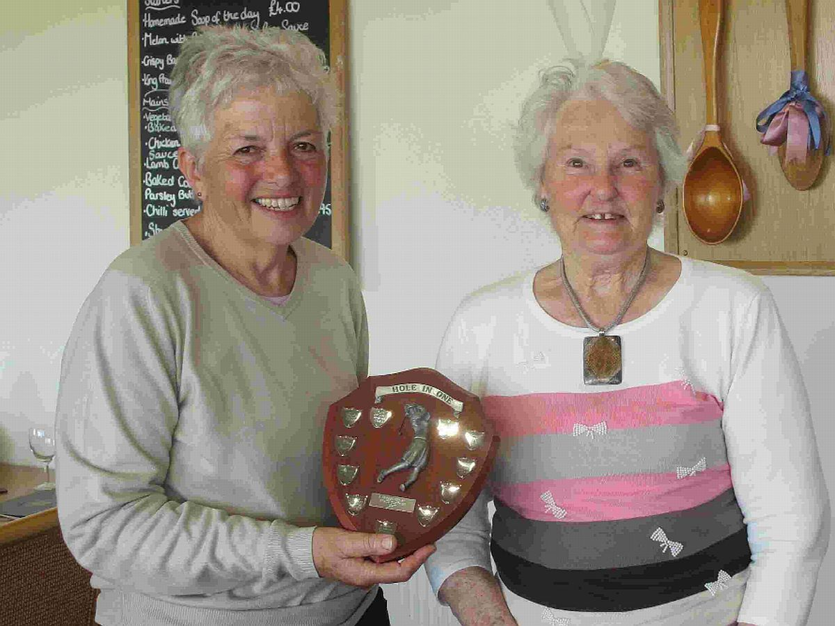 JUST ACE: Grace Clothier, right, presents the Hole-in-one Trophy to Marilyn Wilson