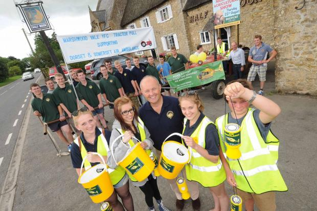 Marshwood Young Farmers pulled a tractor from Half Moon pub at Melplash to West Bay showground in aid of the Air Ambulance last year.