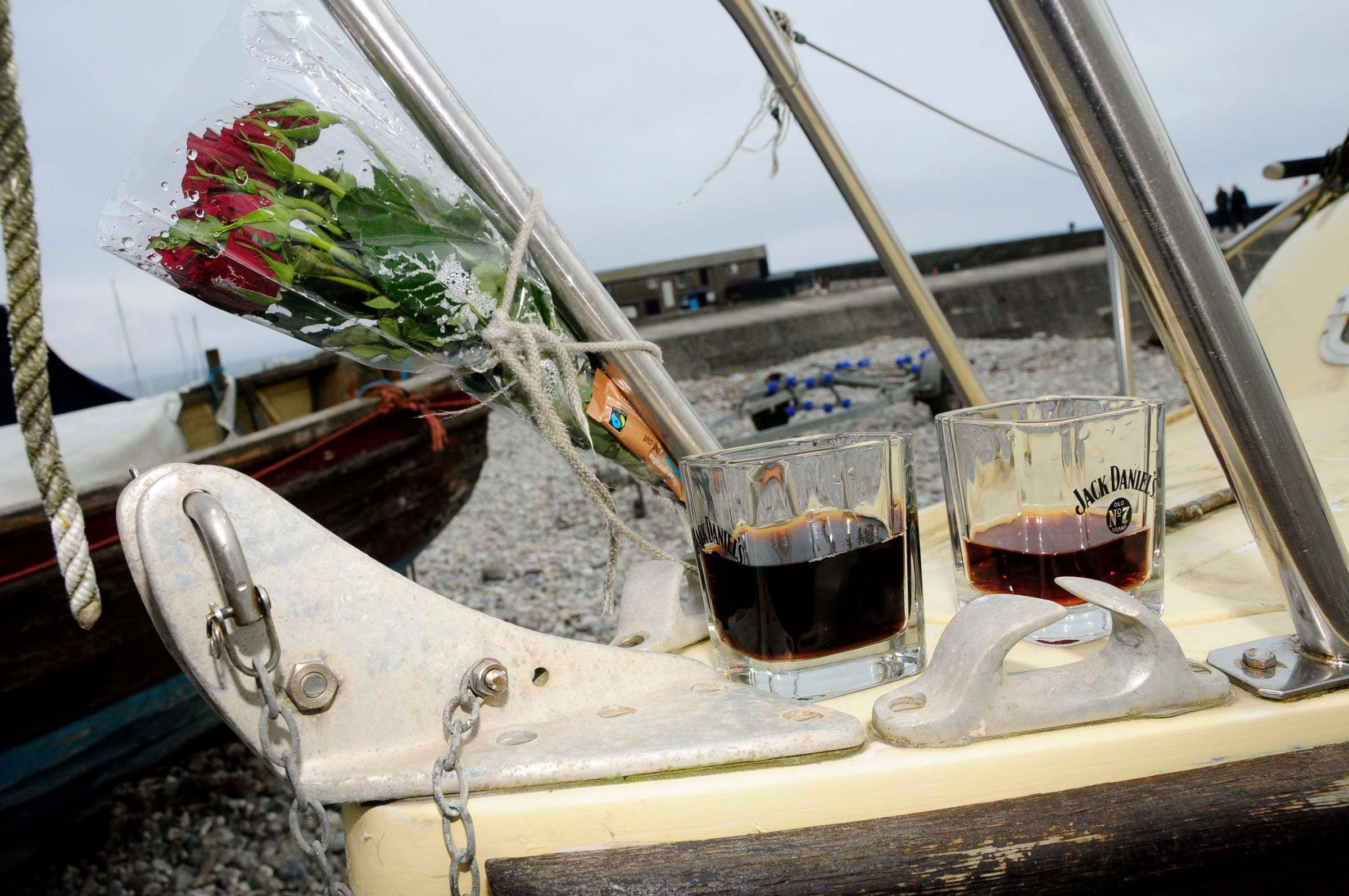 Ken Walton's boat, the Mudlark, with floral tributes left by friends