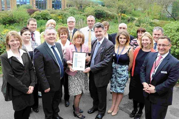 PRAISED: Dorset's crime commissioner Martin Underhill and his team receive the national award for community engagement