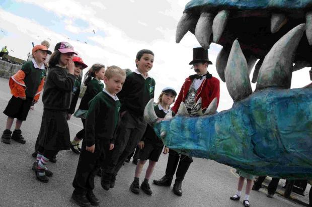 LOTS ON OFFER: Jonny Hoskins shows pupils from Portesham Primary School, Horace the travelling Pliosaur Cinema at last year's event