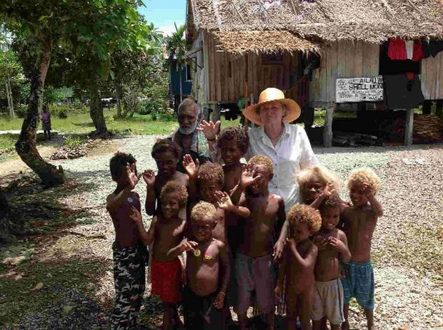 WARM WELCOME: Pat McEvoy with children at Buma, Malaita