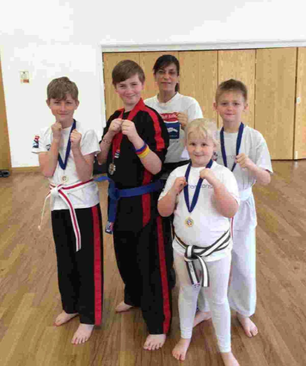 SCHOOL SKILLS: From left, Tyler Nottley, Aiden Cooper, Charlotte Passmore and Jack Gosney, with instructor Lucy Fear