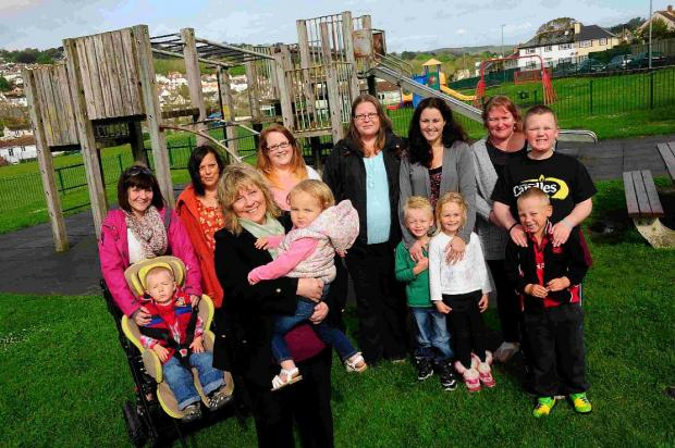 HAPPY: Lyme Regis Play Park Fundraising Association members with their children at Anning Road play park
