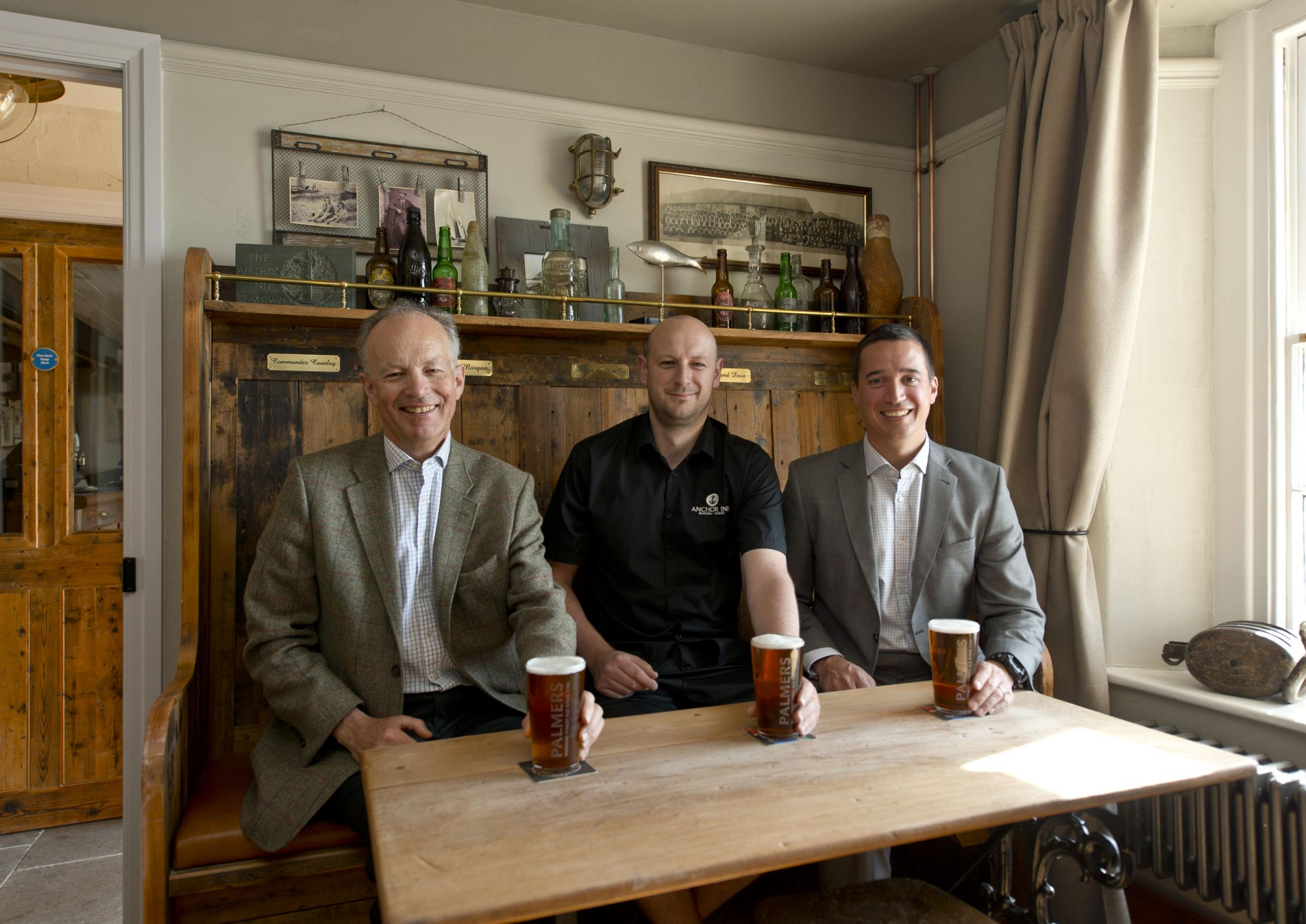 John Palmer, Chairman of Palmers Brewery, Paul Wiscombe, landlord of The Anchor Inn and Jayson Perfect, Palmers Brewery Tenanted Trade Director, enjoy a pint at the new-look pub.