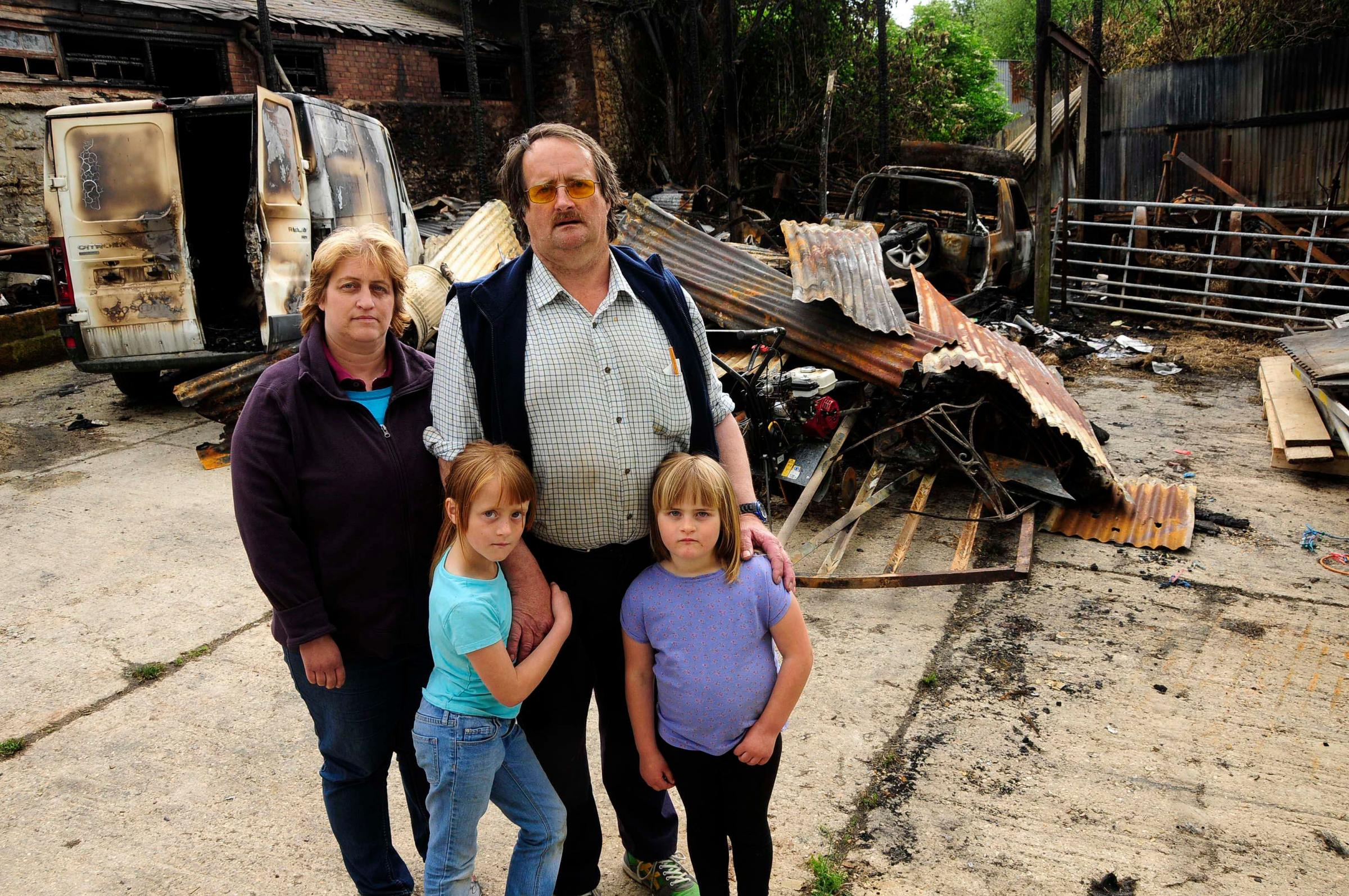 Farmer Brian Johnston and family with the fire damage
